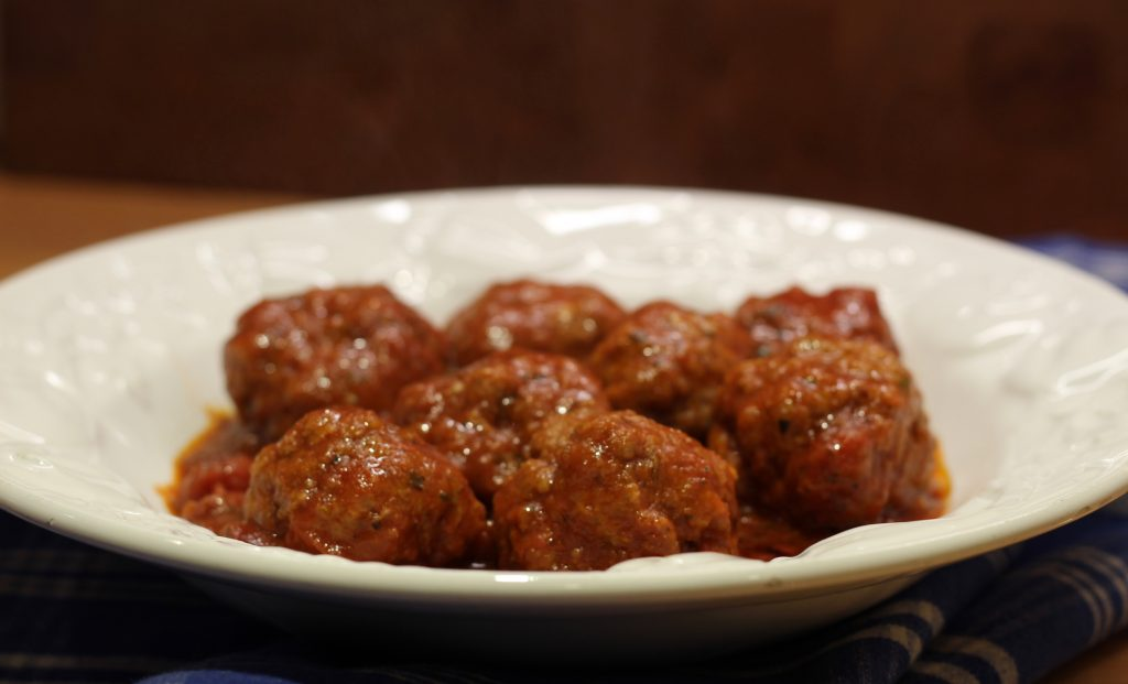 meatballs on a white ceramic dish