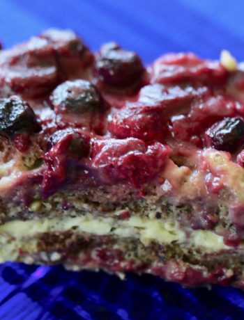 blueberry raspberry French toast on a blue glass plate