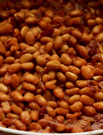 vegetarian baked beans in a white ceramic baking dish