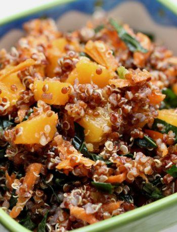 quinoa salad in a square bowl on a white cloth