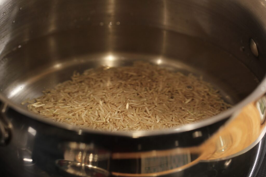 brown rice in a pan of water